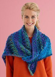 This Easy Lace Triangle Shawl is the perfect addition to any woman's wardrobe. It's an easy crochet pattern to complete using Lion Brand DaVinci yarn in any color of your choice. This stylish shawl can be worn any time of the year.