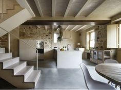 Beautifully restored stone house in Spain with classic mid-century furniture, large kitchen island, sleeping loft with deck & skylights by Dom Arquitectura. Scandinavian Interior Design, French Interior, New Kitchen Designs, Modern Kitchen Design, Architecture Renovation, Large Kitchen Island, Traditional Style Homes, Stone Facade, Stone Houses