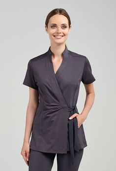 The Andiamo Wrap Woman's Top - Black, Charcoal or White - The Andiamo Wrap Woman's Top - Black or Charcoal is a lightweight tunic created with our signature stretch fitness fabric. Ties together on the left side with an inside button closure for a secure Salon Uniform, Spa Uniform, Hotel Uniform, Scrubs Uniform, Uniform Ideas, Corporate Uniforms, Staff Uniforms, Work Uniforms, Beauty Uniforms
