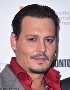 Johnny Depp looked notably different as he joined Amber Heard at the Toronto International Film Festival premiere of Black Mass on Monday