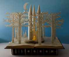 Fairytale Castle - Book Sculpture - Book Art - Altered Book Made by cutting, folding and glueing the pages of a Spanish book to create this