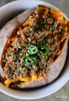 Chili Stuffed Sweet Potatoes makes a quick and easy meal! Ready and on the table in 30 minutes or a great make-ahead meal for even easier weeknights! If your day goes anything like mine, it begins in a rush out the door to school, stays running on full throttle and then winds up with everyone...