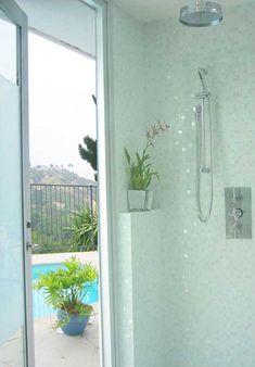 white glass tiles    http://www.susanjablon.com/media/content/images/gallery/bath/photosbath1-white-glass-tile-mosaic-shower.jpg