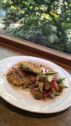Fresh Turmeric and Spinach Fritters with an olive side salad