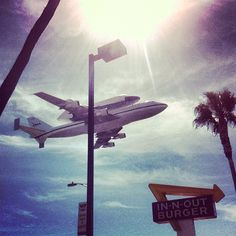 Endeavour flying over the In-N-Out Burger near LAX