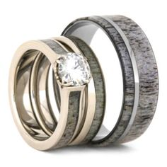 This deer antler wedding ring set is perfect for any hunters or couple who enjoys the wildlife. The bridal set is made with 10k white gold and has a forever brilliant moissanite gemstone with a unique antler prong setting. The men's ring is crafted with a comfort fit titanium sleeve and thin titanium pinstripe.