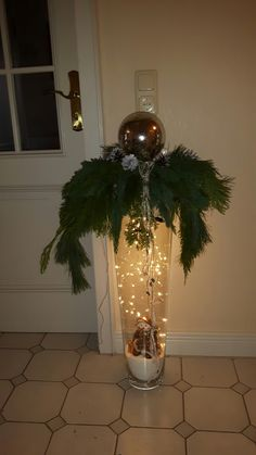 tall vase with hanging christmas balls lights I know this is the wrong color mor. - Beliebteste Bilder tall vase with hanging christmas balls lights I know this is the wrong color mor. Decoration Christmas, Noel Christmas, Outdoor Christmas, Christmas Balls, Xmas Decorations, Christmas Humor, Christmas Wreaths, Christmas Ornaments, Christmas Porch