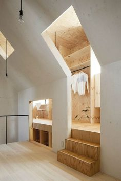 Larch plywood clads personal spaces which wrap around a central living area in a Japanese home by MA-style Architects. - Architecture and Home Decor - Bedroom - Bathroom - Kitchen And Living Room Interior Design Decorating Ideas - Design Exterior, Interior Exterior, Interior Architecture, Japanese Architecture, Interior Doors, Retail Interior, Interior Paint, Interior Cladding, Fashion Architecture