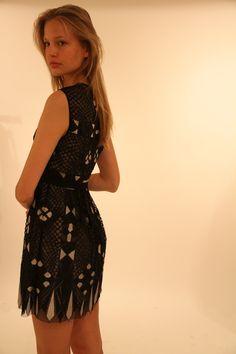 Elisabeth's dynamic lace-knit dress accompanied by undeniable allure. #bcbg #standout