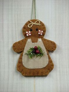 vikki posted O Christmas Tree: Gingerbread Girl Ornament to their -quilting fever- postboard via the Juxtapost bookmarklet. Felt Christmas Decorations, Christmas Ornaments To Make, Christmas Sewing, Felt Ornaments, Homemade Christmas, Christmas Projects, Felt Crafts, Holiday Crafts, Christmas Crafts