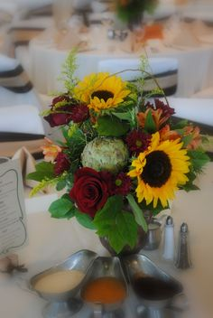 like the yellow and burgundy/ wine colors. Don't want sunflowers in the bouquets, but great for centerpieces. LOVE the artichoke in this centerpiece too
