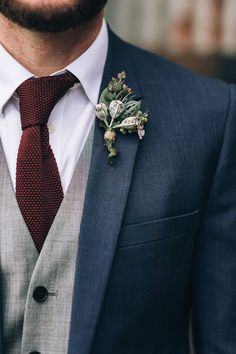 Navy groom suit with grey vest, burgundy knit tie and gumnut boutonniere | Raconteur Photography