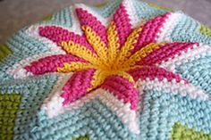 Texture tuft: free ravelry download for this pillow... ravelry calls it a pinwheel, but ir reminds me of a Star Gazer Lily