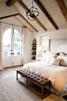 Beach House with European Flair contemporary bedroom - like natural timber against the whitewash for the poolhouse