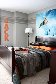 Boys room- light grey with a darker grey stripe and orange lettering name.