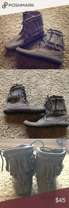 Minnetonka lace up boots Ugh, trying to make room in my closet and these have to go! I wore them once around the house. Perfect condition, no stains or flaws. Seven inches tall. Dark grey color. Minnetonka Shoes