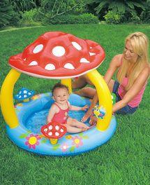 Piscina para bebés insuflável com fundo macio e pára-sol com forma de cogumelo.