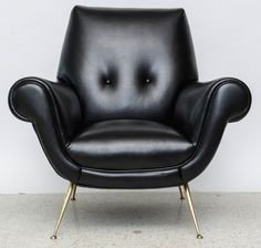 Gigi Radice; Leather and Brass Lounge Chair by Minotti, 1950s.