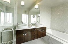 Mark English Architects: Chic modern bathroom design with modern walnut veneer floating bathroom vanity with ...