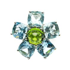 Aquamarine and Peridot Flower Ring   From a unique collection of vintage cocktail rings at http://www.1stdibs.com/jewelry/rings/cocktail-rings/