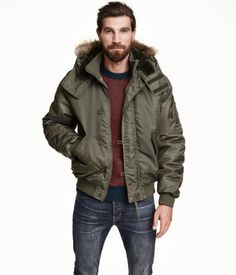 Khaki green padded pilot jacket in woven fabric with a ribbed stand-up collar. Pile-lined hood with faux fur trim and Velcro fastener at front. | H&M For Men