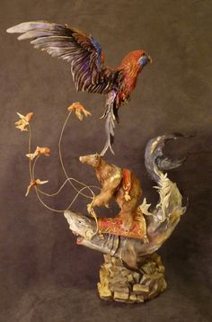 Creature sculpture by Ellen June- Random elements brought together beautifully. Excellent work, the only things I'd do different is even out the proportions. I'd make the bear a little bit bigger and shrink the big bird, but keep it slightly larger than the gold fish :)