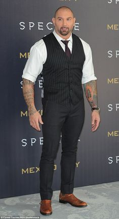 Dapper: Dave Bautista displayed his tattoos in a white shirt and waistcoat combo...