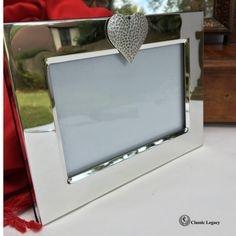 "This silver frame is engrave-able and holds a 4"" x 6"" photo. It has a antique silver hammered heart on the top of the frame. The frame has a black velvet backing with an easel which enables the frame to stand.   The outside dimensions are 7.5"" x 5.25"". Gifts For Wine Lovers, Wine Gifts, Anniversary Photos, Anniversary Gifts, Hammered Silver, Antique Silver, Wine Making Process, Great Wedding Gifts, Wine Bottle Stoppers"