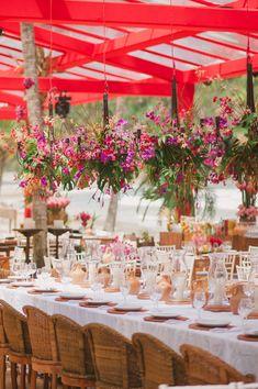 hanging floral arrangements - photo by Piteira Photography http://ruffledblog.com/brazilian-wedding-on-the-beach