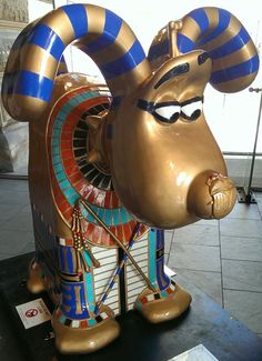 """Gromit Unleashed - Artist Dale Evans' ancient TutanGromit I was inspired by the Egyptian collections at Bristol museum: """"If Gromit was an Egyptian and had lived 3,000 years ago he would have been a god."""" In his specially sculpted Egyptian dress and bejewelled in colour, Gromit certainly looks the part!"""