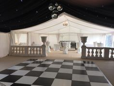 Classic black & white marquee styling with columns & balustrade divide