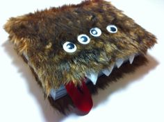 if i got the monster book, would be cool to use as a swap journal!!! teehee! not too fond of these eyes though i like the black beety eyes like in the movie!
