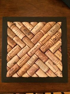 Wine Cork Trivet - 8 1/2 in. x 8 1/2 in. Made to order Supports on bottom made with champagne corks Wood frame painted with 1000 degree paint: #winecorkcrafts