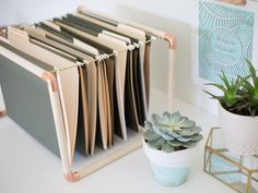These DIY mixed metal file folder hangers will take your office from drab to glam in a heartbeat.