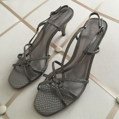 """Ann Taylor Loft pewter sandals. Very elegant and beautiful sandals. Textured leather upper. Very comfortable. Worn very little. Heel is 3"""" tall. Excellent condition. LOFT Shoes Sandals"""