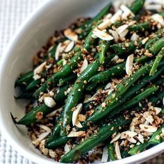 Fresh green beans tossed in a tangy Dijon vinaigrette, crunchy toasted almonds and crispy bread crumbs.