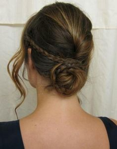 Rolled Bun with braid 1) Start by doing a tiny braid, 2) Then twist the other side of your hair like you were making a rolled pony.  3) Gather all the hair that's left, and pin it into your average low bun