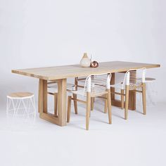 The Bondi Rectangular Dining Table is crafted in a Solid American White Oak wooden and timber top and legs. Featured here with our Xaria American Oak and powder coated steel stool, side table and dining chairs.