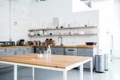 A modern and industrial kitchen in lofty white space