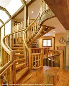 The beautiful wood gives this grand staircase that rustic feel, with some old world charm!