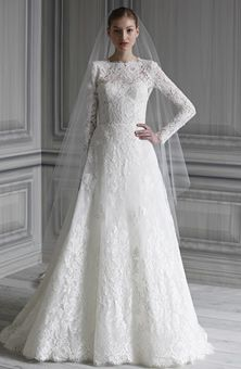 Monique Lhuillier- Catherine Ivory re-embroidered and Chantilly lace long sleeve bateau neck natural waist bodice with hand appliqued A-line skirt. Ivory tulle veil with lace appliques
