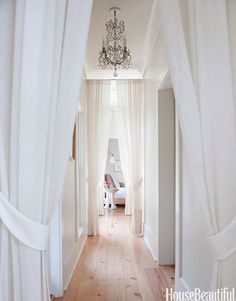 10 Bright White Rooms - Designer Smith Hanes turned a negative in the home into a fresh, beautiful positive: he broke up the long hallway leading to the master suite by adding a row of white portieres. Hallway Curtains, White Curtains, Hanging Curtains, Corner Curtains, Roman Curtains, Layered Curtains, French Curtains, Ikea Curtains, Striped Curtains
