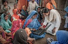 In India many NGOs are serving their duties in rural areas where they make their effort to raise the standard of living for the rural people. Here, in a village of Dhar District, a NGO volunteer is giving basic information about laptops to the tribal women in  a gramsabha (weekly meeting).     Soni Chetan, India    All photos can be found at:  http://www.facebook.com/media/set/?set=a.277391062340658.66699.212428362170262=1=279722588774172
