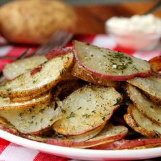 AMAZING. Will make again and again...Baked Herb and Parmesan Potato Slices — a quick, easy, and delicious side dish.
