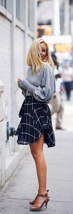 The street style: grey shirt and blue skirt