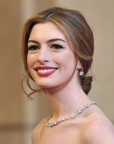 Anne Hathaway hosted the Academy Awards in 2011, but by the look of her red lips and soft-swept center-parted 'do, she might as well have been walking down the aisle. Loose tendrils framed her face to complete this supremely romantic style.