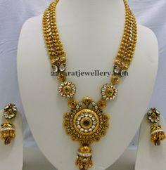 Jewellery Designs: Gold Swirls Long Set with Jhumkas