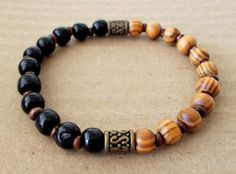 Men's Burly Wood and Black Wooden Beaded Stretch Bracelet by fancyfreeboutique on Etsy