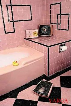 Intersecting black rectangle frames in pink-tiled bathroom