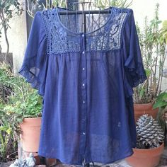 Pretty blue top. Pretty gauze and lace top with butterfly sleeves with ruffle trim. Worn a couple of times. In excellent condition. 26/28 Avenue Tops Blouses